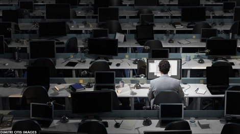worker-alone-dark-office
